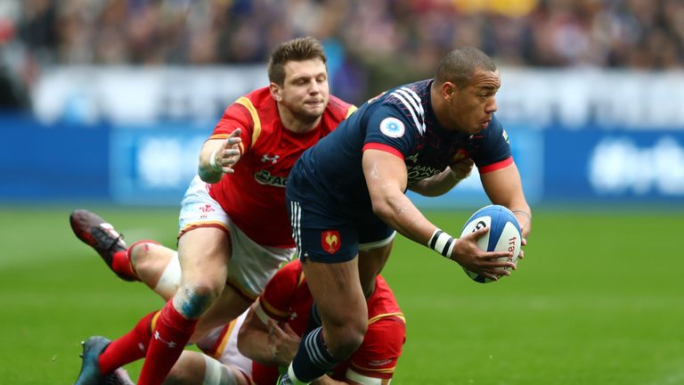 Gael Fickou of France looks to offload as he is tackled by Dan Biggar