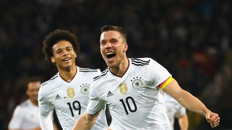 Lukas Podolski celebrates scoring against England on his final international apperance
