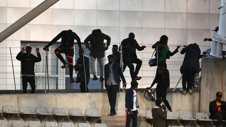 Spectators climbed over railings to get into the stadium