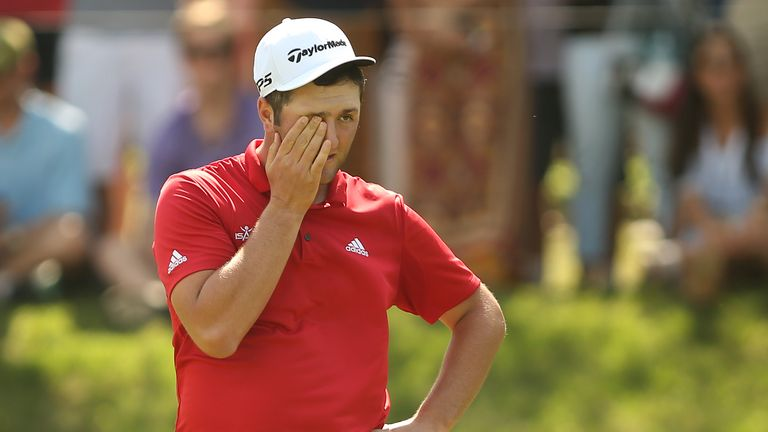 Rahm shows the strain after being five down after eight, but he began his fightback at the ninth