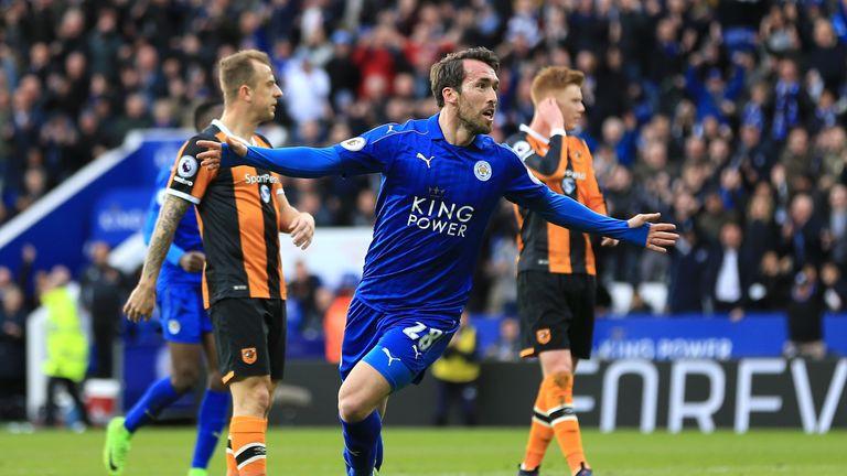Christian Fuchs (L) celebrates Leicester's equaliser