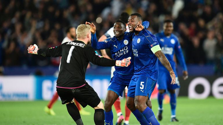 Leicester players celebrate a famous victory over Sevilla