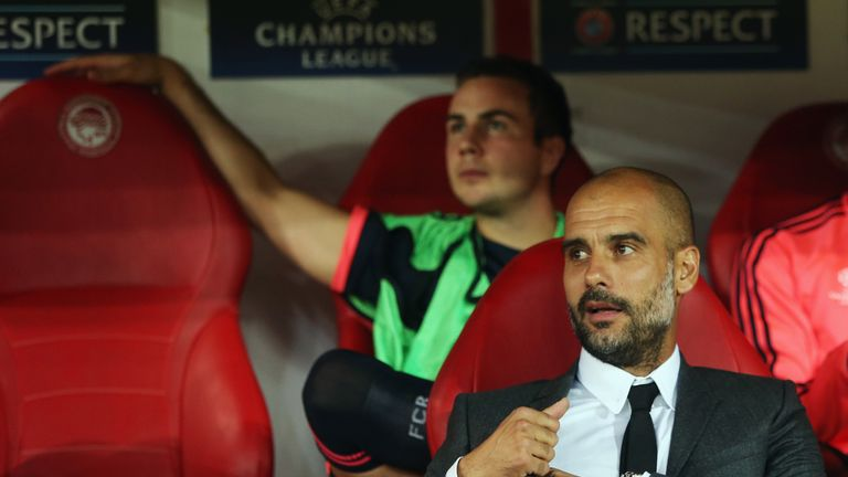 Pep Guardiola watches on with Gotze on the bench at Bayern Munich
