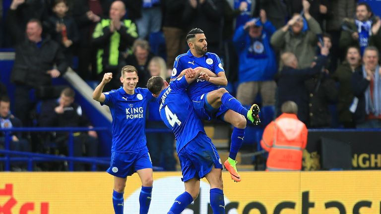 Riyad Mahrez (R) celebrates scoring his side's second goal with Danny Drinkwater (L)