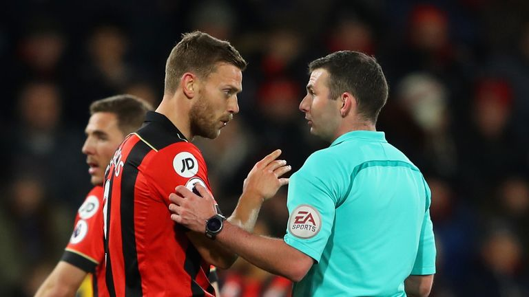 Bournemouth captain Simon Francis in conversation with referee Michael Oliver