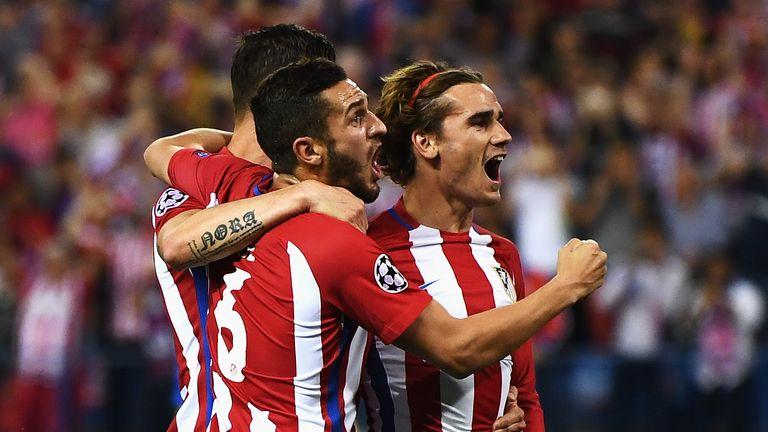 Griezmann celebrates with team-mates