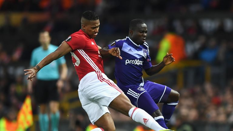 Frank Acheampong is tackled by Antonio Valencia