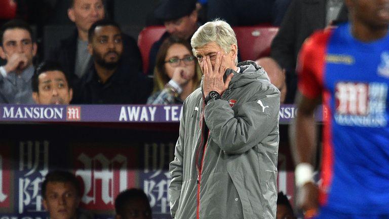 Wenger endured a miserable evening watching Arsenal lose at Selhurst Park