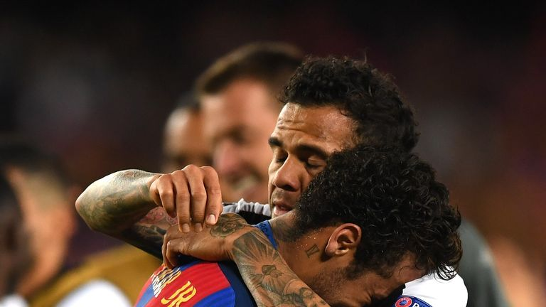 Neymar embraced by Dani Alves after Juventus knocked out Barcelona in the Champions League