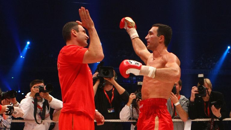 Brothers in arms: Vitali and Wladimir celebrate in the ring.