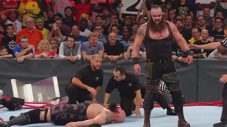 Braun Strowman stands above Big Show in a collapsed ring after a chaotic main event on RAW