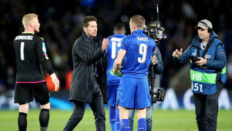 Atletico Madrid manager Diego Simeone goes to shake hands with Jamie Vardy after Leicester's defeat