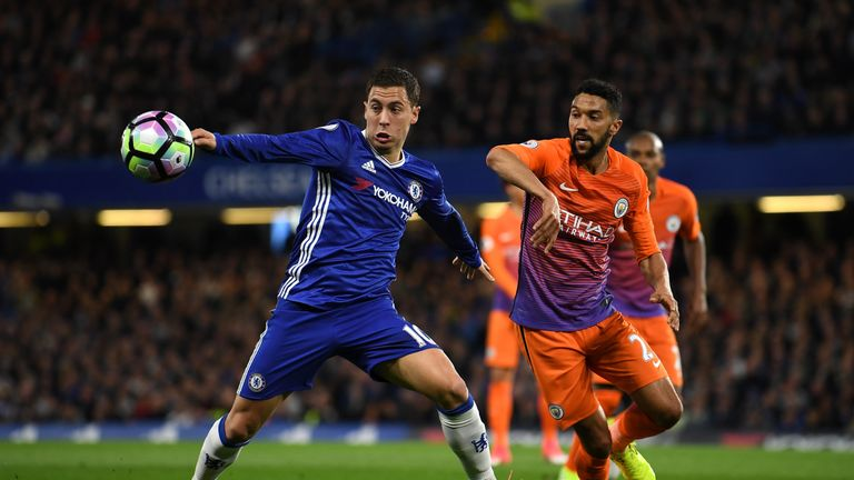 Eden Hazard and Gael Clichy battle for possession