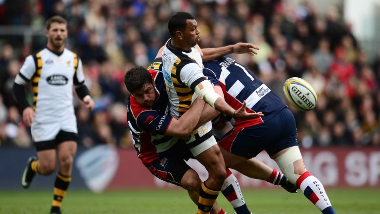 Kurtley Beale offloads the ball in the tackle against Bristol