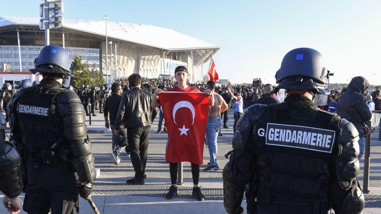 Anti-riot Police contain Besiktas supporters outside Parc Olympique Lyonnais