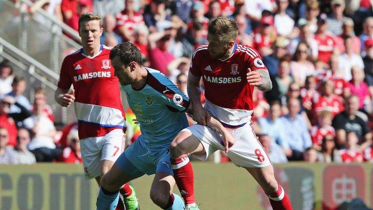 Ashley Barnes and Adam Clayton battle for possession