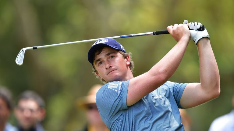Paul Dunne hit the pin moments after Lee Westwood's approach had done the same