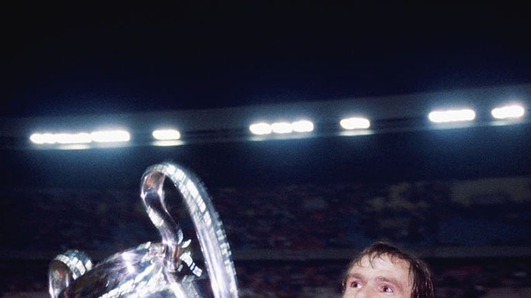 Liverpool captain Phil Thompson parades the trophy after their 1-0 victory over Real Madrid