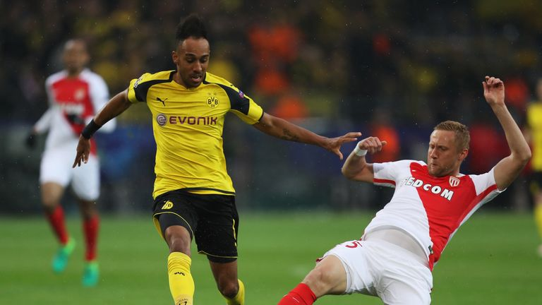 Kamil Glik looks to tackle Pierre Emerick Aubameyang in the first half