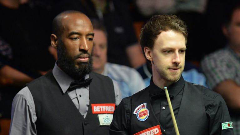 Judd Trump (r) suffered a shock defeat to Rory McLeod