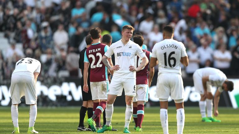 Swansea's players show their dejection at the final whistle