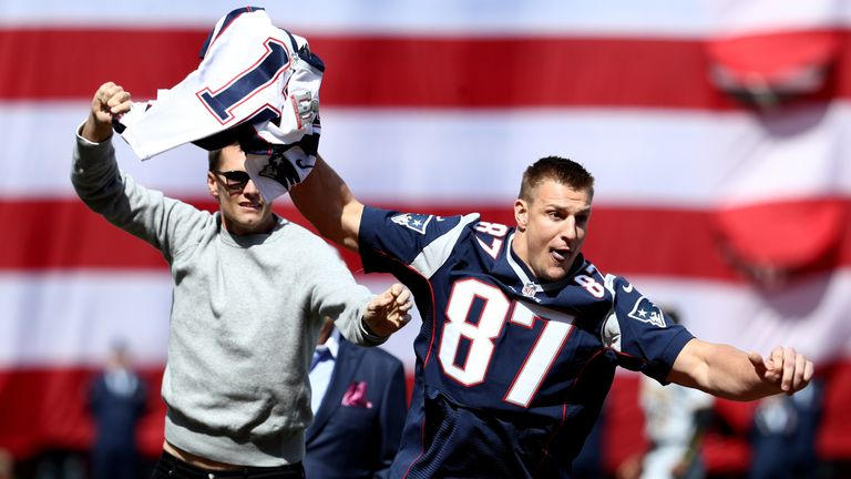 Rob Gronkowski of the New England Patriots steals Tom Brady's jersey ahead of Monday's Boston Red Sox game