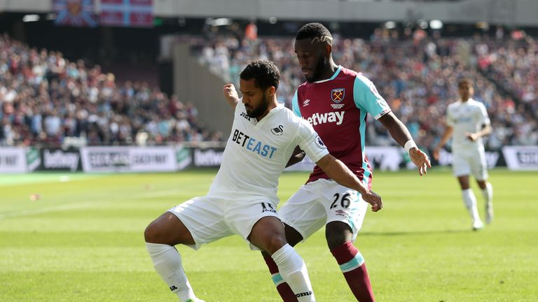 Wayne Routledge (left) is put under pressure by Arthur Masuaku of West Ham