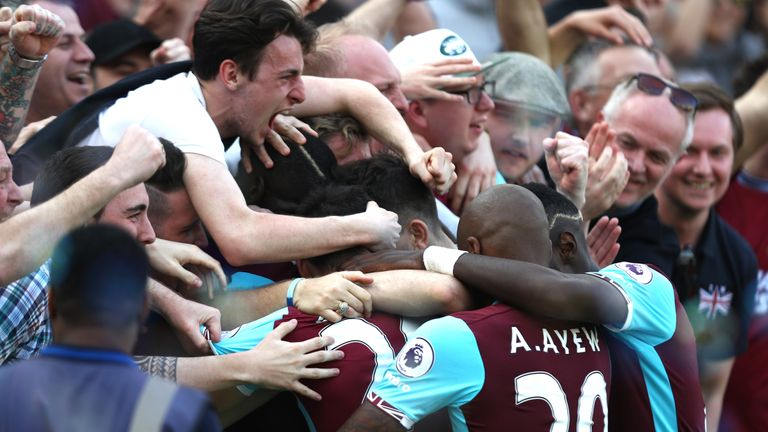 West Ham United's players celebrate their winning goal against Swansea