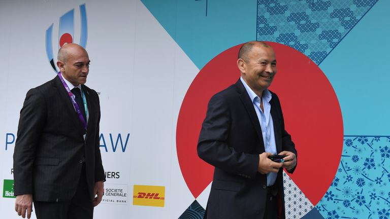England's head coach Eddie Jones (R) arrives at the Kyoto state guesthouse to attend the Rugby World Cup draw