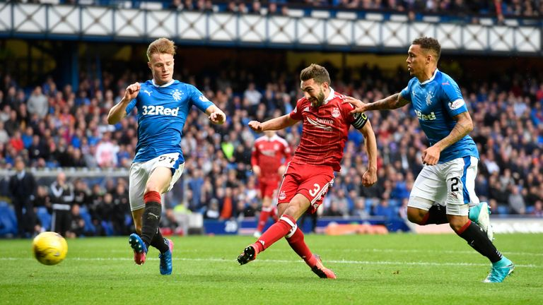 Graeme Shinnie (centre) opens the scoring during the 2-1 win last season, the Dons' first win at Ibrox in 26 years