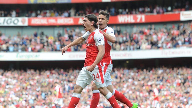 Hector Bellerin amd Gabriel Paulista celebrate an Arsenal goal