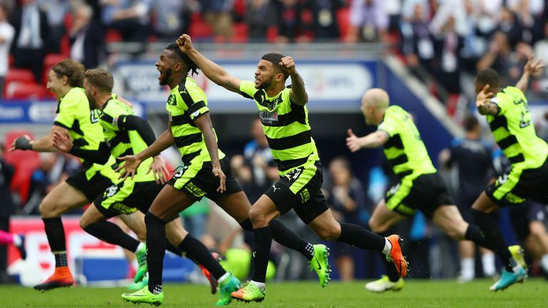 Huddersfield players celebrate their dramatic promotion to the top flight