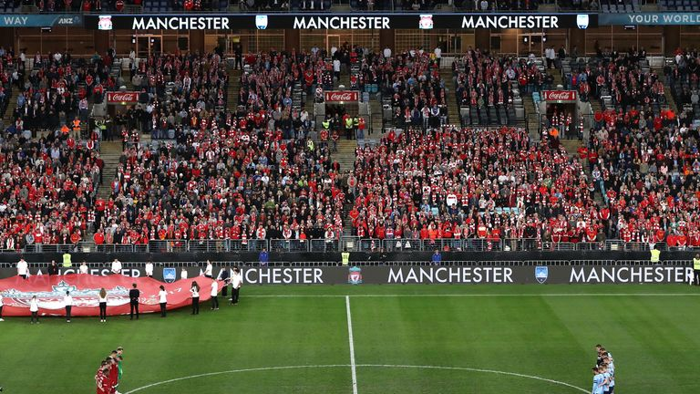Players observe a minute's silence for the victims of the recent Manchester bombing