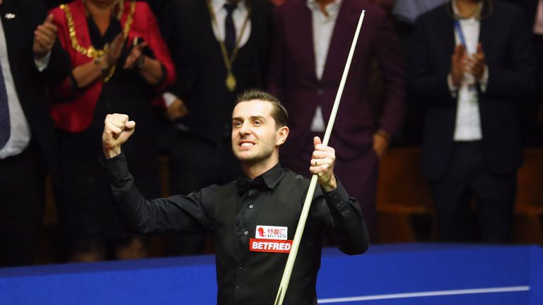 Mark Selby celebrates retaining his World Championship title in Sheffield