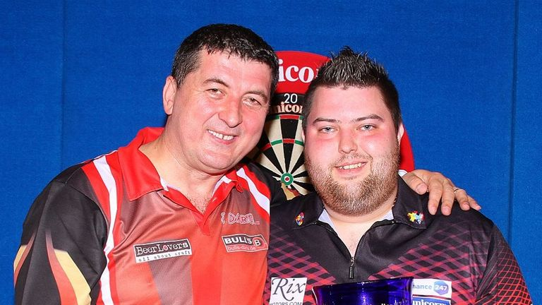 Michael Smith (right) beat Mensur Suljovic to claim the Gibraltar Darts Trophy