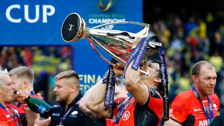 Saracens flanker Michael Rhodes drinks from the trophy in Edinburgh