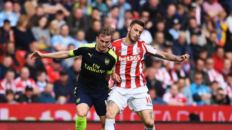 Rob Holding and Marko Arnautovic in action at the bet365 Stadium