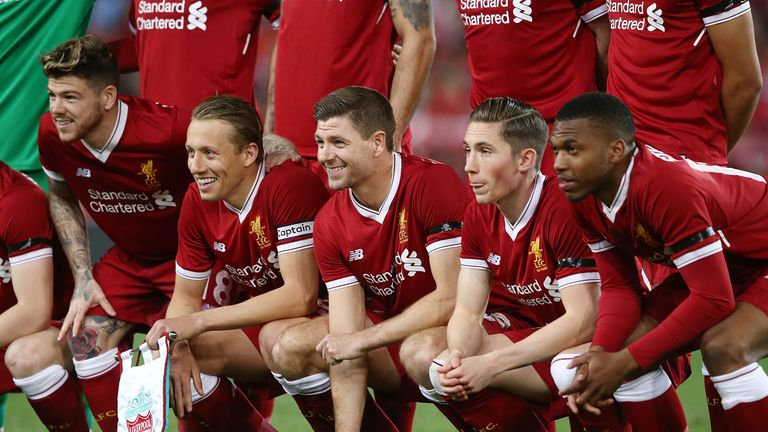 Steven Gerrard poses in a Liverpool line-up
