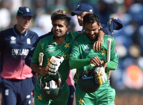 Pakistan's Babar Azam and Mohammad Hafeez celebrate victory