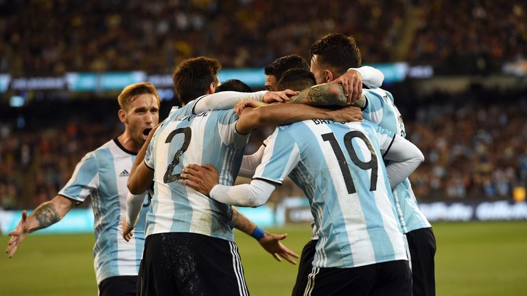 Argentina's players celebrate Mercado's goal
