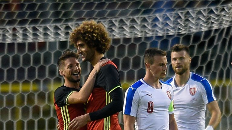 Belgium midfielder Marouane Fellaini (middle) celebrates after scoring during a friendly