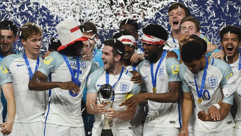 England's players with the trophy after winning the U20 World Cup