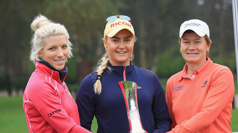 Mel Reid of England, Charley Hull and Catriona Mtthew of Scotland hold the trophy during the Ricoh Women's British Open Media Day