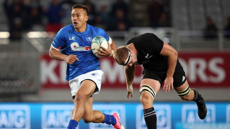 Samoa's Tim Nanai-Williams gets away from Sam Cane