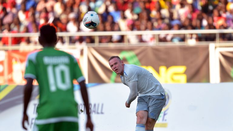 Wayne Rooney curls home his first goal since returning to Everton