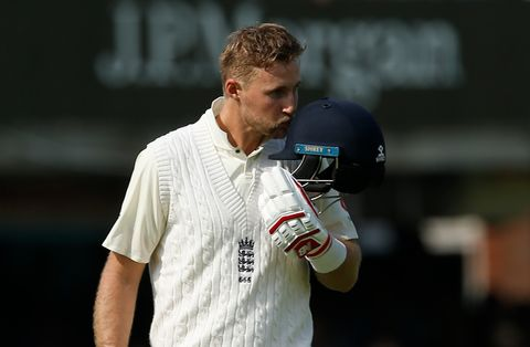 Joe Root kisses the England badge after reaching three figures at Lord's