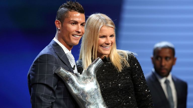 Real Madrid's Cristiano Ronaldo (L) poses with Lyon's Norway forward Ada Hegerberg in Monaco