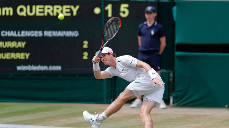 Britain's Andy Murray returns against US player Sam Querrey during their men's singles quarter-final match on the ninth day of the 2017 Wimbledon Champions