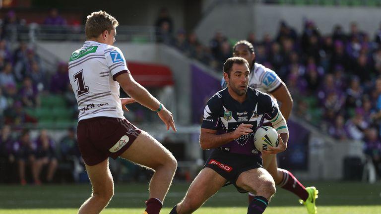 Cameron Smith runs the ball for Melbourne