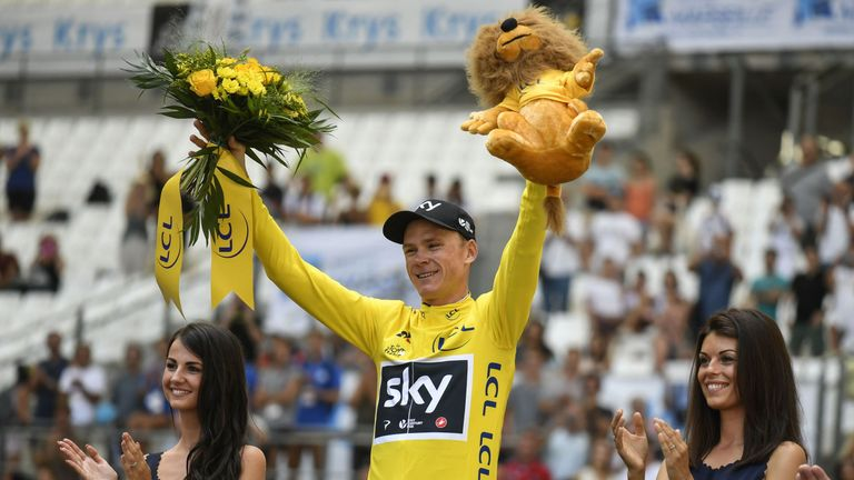 Froome celebrates his overall leader yellow jersey on the podium